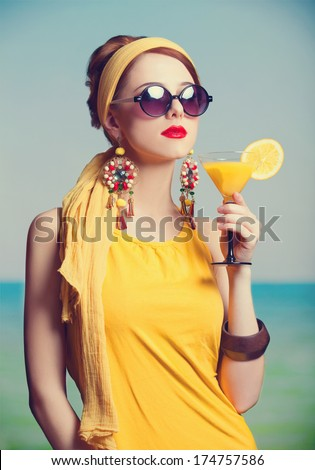 Redhead women with coktail. Photo in retro color style. - stock photo