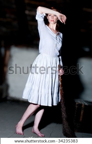 Redhead young woman dressed up like cinderella at attic - stock photo