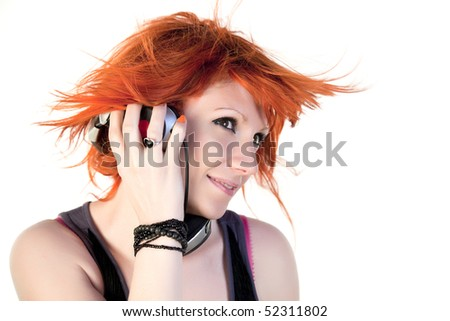 Redhead young woman holding headphones dancing - stock photo