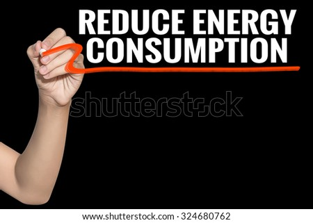 Reduce Energy Consumption word write on black background by woman hand holding highlighter pen - stock photo