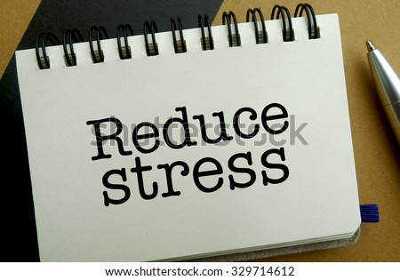 Reduce stress memo written on a notebook with pen