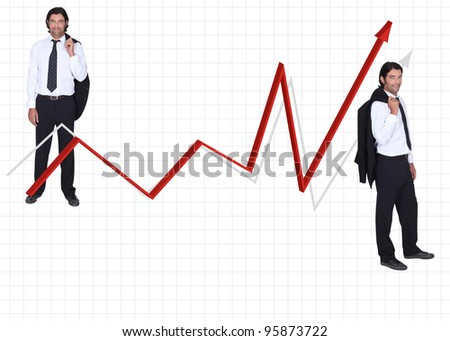 reduced size man in coat and tie on either side of red arrow against graph paper