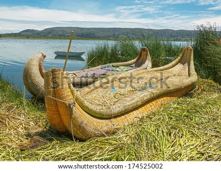 Reed boat on Island of Uros. Titicaca (Titiqaqa) is a lake in the Andes on the border of Peru and Bolivia - stock photo
