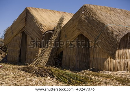 Reed hut on floating Uros Island upon Lake Titicaca, Peru. - stock photo