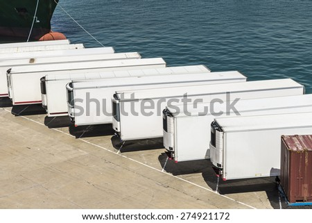 Reefer containers waiting to board at the port of Barcelona, Catalonia, Spain - stock photo