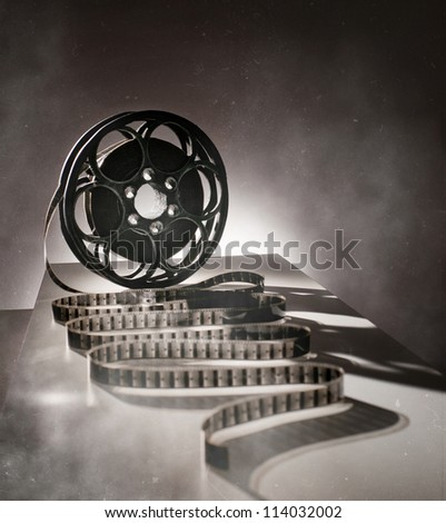 Reel of film in retro style - stock photo