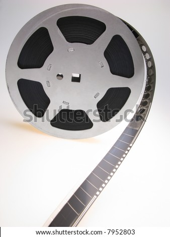 reel of  film of 16 mm on  white background, close up - stock photo