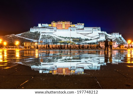 Refection of Potala Palace in Tibet of China - stock photo