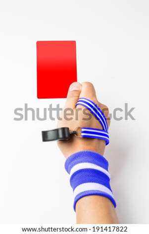 Referee hand and whistle show card to player with white background - stock photo