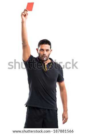 Referee holding a red card - stock photo