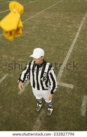 Referee Throwing Penalty Flag - stock photo