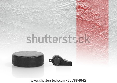 Referee whistle, washer and a fragment of ice hockey rink. Background - stock photo