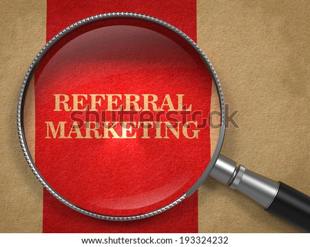 Referral Marketing Concept. Magnifying Glass on Old Paper with Red Vertical Line Background. - stock photo