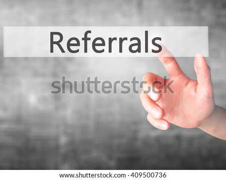 Referrals - Hand pressing a button on blurred background concept . Business, technology, internet concept. Stock Photo - stock photo