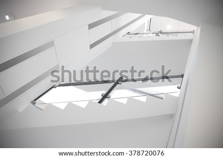 Refined photo of modern staircase hallway in sterile white colors. Substantial digital alteration / substitution of remarkable architectural elements with other ones made this image unrecognizable. - stock photo