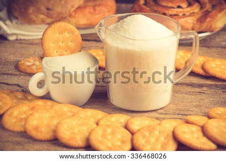 refined sugar and granulated sugar and cracker vintage color - stock photo