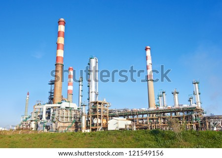 Refinery against a blue sky - stock photo