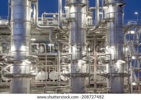 Refinery distiller columns at night. - stock photo