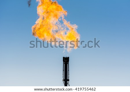 Refinery flare - burning of dangerous gases in the oilfield  - stock photo