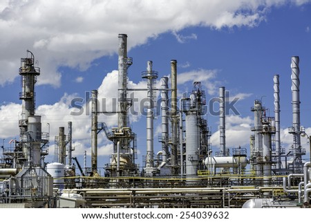 Refinery for oil with cloudy sky and pipes - stock photo