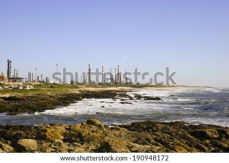 Refinery near de Ocean - stock photo