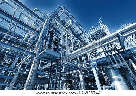 refinery pipelines constructions, illuminated concept - stock photo