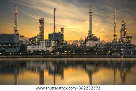 Refinery plant area at sunrise - stock photo