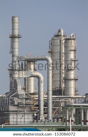 Refinery tower in chemical plant with blue sky