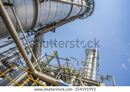 Refinery tower with blue sky - stock photo