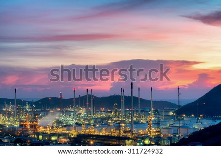 Refinery with tube and oil tank along twilight sky at beautiful - stock photo
