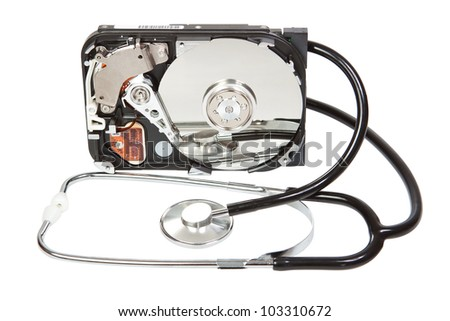 Reflected in the hard disk, a stethoscope. Diagnostic. - stock photo