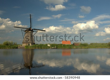 Reflected windmill with fluffy clouds, Holland