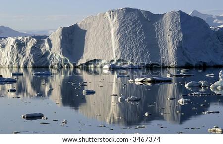Reflecting iceberg - stock photo