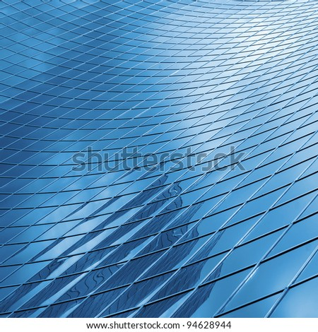 reflecting sky in glass of office  building ; abstract  background - stock photo