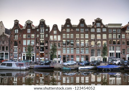 Reflecting townhouses in Amsterdam, the Netherlands, HDR - stock photo