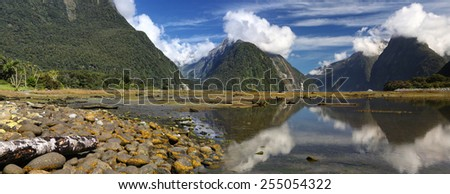Reflection at Milford Sound (Fjordland, New Zealand) - Panrama - stock photo