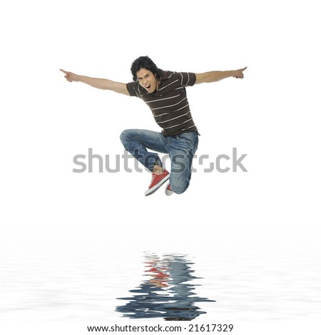 Reflection for One very happy energetic man jumping into the air - stock photo