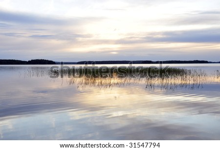 Reflection in a lake - stock photo