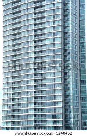 Reflection in an office building glass wall or a Condominium loft building face - stock photo
