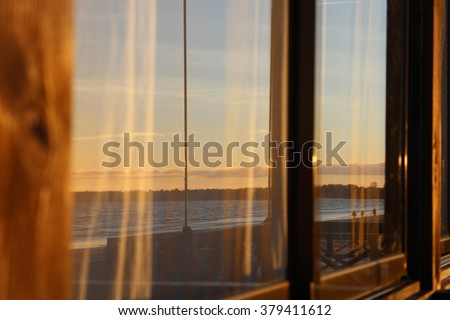 Reflection in glass seaside cafe. - stock photo