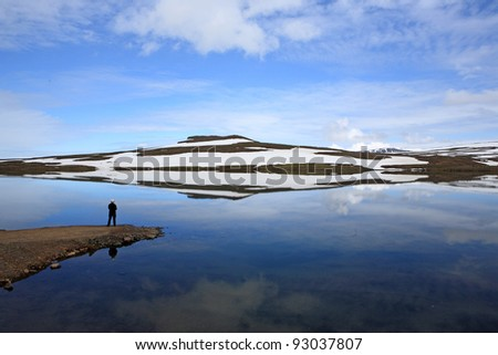 Reflection in lake near Seydisfjordur, Iceland - stock photo
