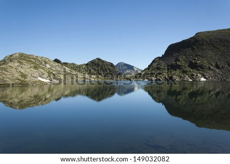 reflection in mountain lake in Austria, Schladming, Klaffersee. - stock photo