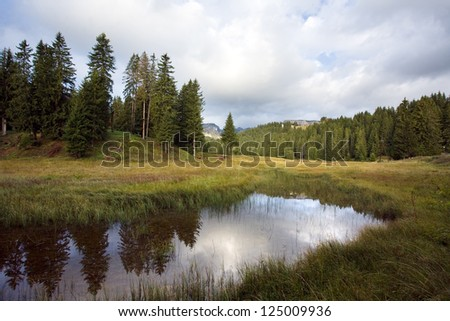 Reflection in smooth water of mountain lakes