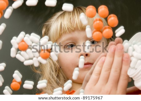 reflection in the mirror girl with pills - stock photo
