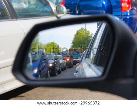 reflection in the mirror of a car, congestion - stock photo