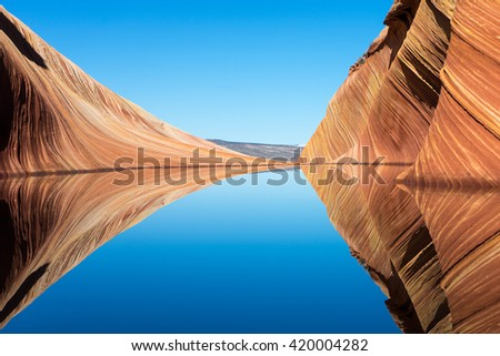 reflection in the wave in coyote butte wilderness area usa - stock photo
