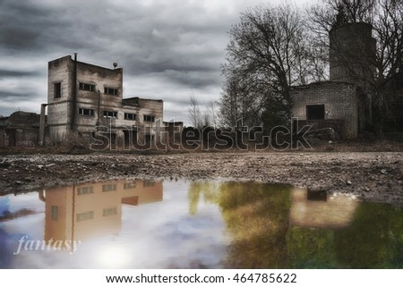 reflection in water of house ruins