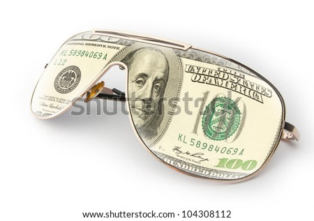 Reflection of a $100 bill in sunglasses - stock photo