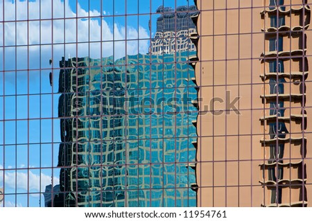 Reflection of a downtown highrise buildings in Dallas - stock photo
