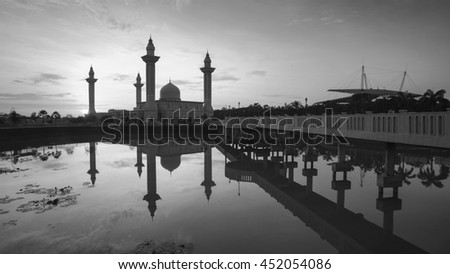 Reflection of a modern beautiful mosque during blue hour sunrise in Shah Alam, Malaysia. Noise slightly visible due to high iso and long exposure. - stock photo